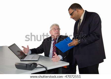 a caucasian senior businessman being instructed by his boss, a mature African-American manager, isolated on white background - stock photo