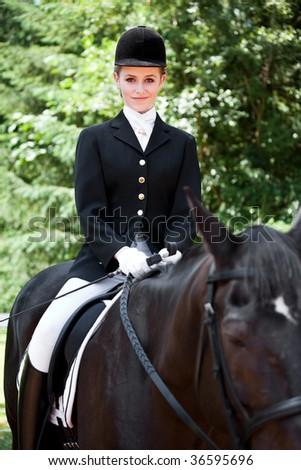 A caucasian teenage girl riding a horse outdoor - stock photo