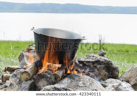 a cauldron on a fire