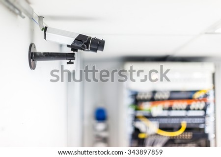 a cctv security surveillance camera in a server room - stock photo