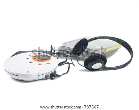 a cd player, cds and headphones isolated on white. focus on right headphone. - stock photo