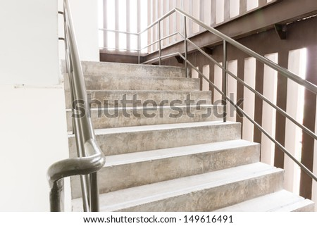 a Cement fire escape in the building - stock photo