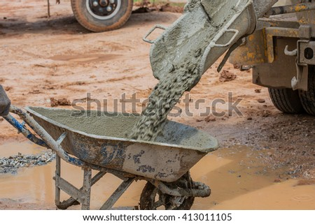 A cement truck is pouring cement - stock photo