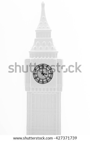 A ceramic tower clock isolated on white background. A clock is resemble to Big Ben. Big Ben is a famous tourist attraction in London. (North end of the Westminister Palace, London) - stock photo