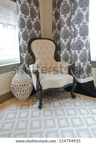 A chair and a decorative vase in the corner of the room. Fragment. Interior design. Vertical. - stock photo