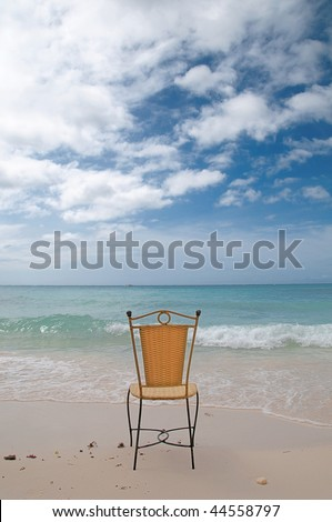 a chair on a lonely tropical beach
