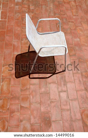 a chair waiting for a relaxing sunbath, alone on the terrace - stock photo