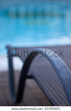 a chaise longue and swimming pool edge - stock photo