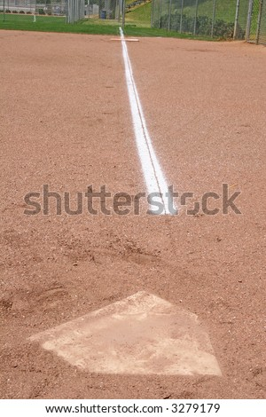 A chalk baseline from home plate to first base on a baseball field - stock photo