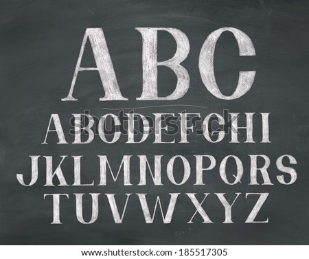 A chalk font on a dark black board background. Raster.
