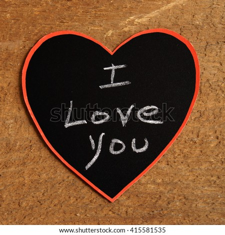 A chalkboard message with I Love You handwritten inside a heart shape. - stock photo