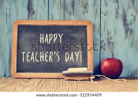 a chalkboard with the text happy teachers day written in it, a piece of chalk, an eraser and a red apple on a rustic wooden table, with a retro effect