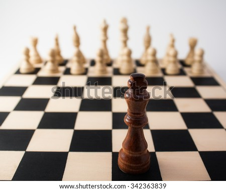 A challenge awaits this one lone piece against a group of many others - stock photo