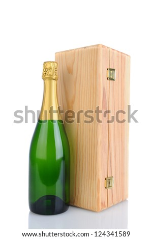 A Champagne bottle in front of a wood gift box. Vertical Format isolated on white with reflection. - stock photo