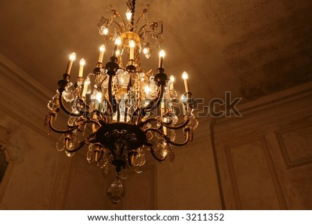 a chandelier hanging in an old room