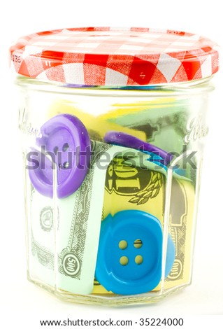 A change jar full of toy money - stock photo