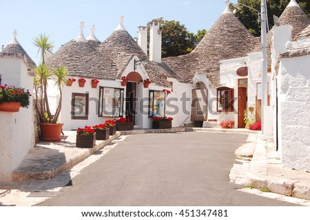 A characteristic square of Alberobello with its famous Trulli in Apulia - Italy