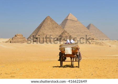 A chariot card heads at Pyramids - Cairo, Egypt - stock photo