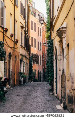 A charming, colourful street in the historic center of Rome, Italy