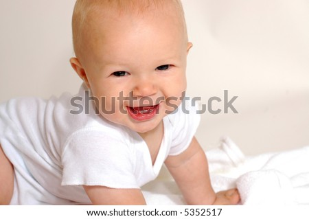 A charming portrait of a little baby boy.  He is 6 months old in this series. - stock photo