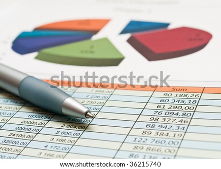 A chart with a pen - stock photo