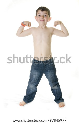 A Cheerful kid showing how strong he is ( powerful concept )