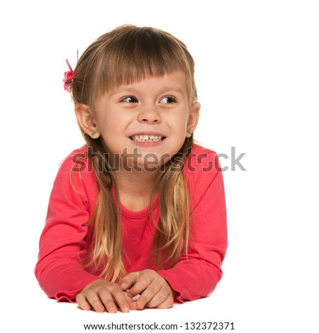 A cheerful little girl in red on the white background