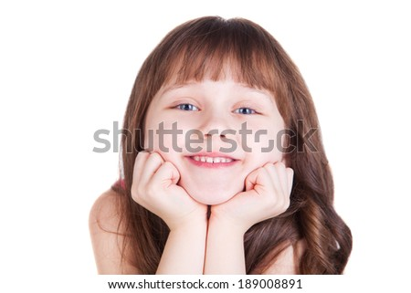A cheerful little girl isolated on the white background - stock photo