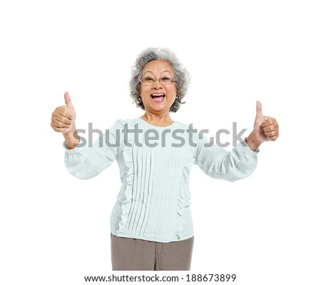 A Cheerful Old Casual Woman Giving a Thumbs Up - stock photo