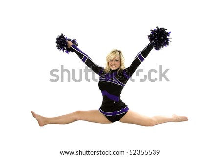 A cheerleader is doing the splits and has her pom poms in the air.
