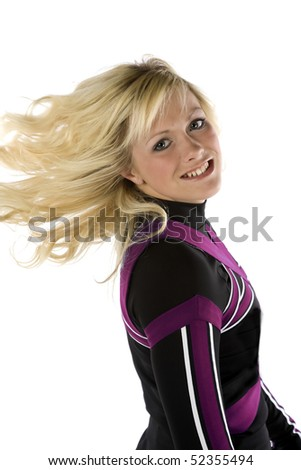 A cheerleader is flipping her hair and smiling - stock photo