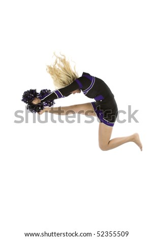 A cheerleader is in the air after jumping into the cowboy position - stock photo