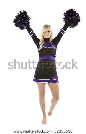 A cheerleader is standing with her pom poms up in the air