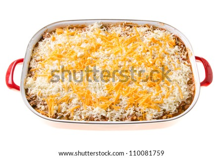 A cheesy casserole in a large dish, isolated against a white background. - stock photo