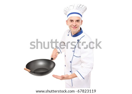 A chef holding a wok welcoming isolated against white background - stock photo