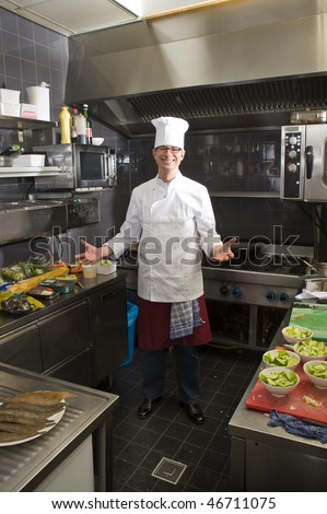 A chef in his kitchen, preparing dinner - stock photo