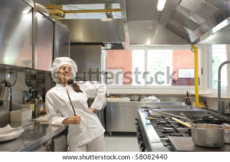 A chef is beaming into her kitchen - stock photo