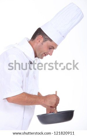 A chef preparing a meal - stock photo