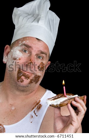 A chef shows off his failed cake consisting of a piece of burnt toast, with chocolate and vanilla icing and a birthday candle. - stock photo