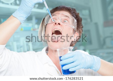 A Chemist is showing an abnormal behavior in her laboratory. - stock photo