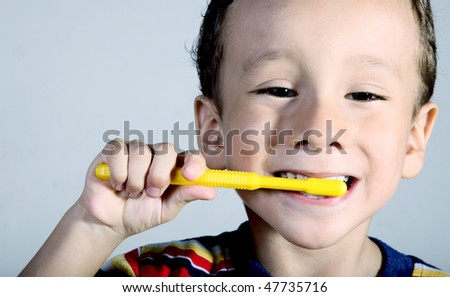 A child brushing his teeth. Close up