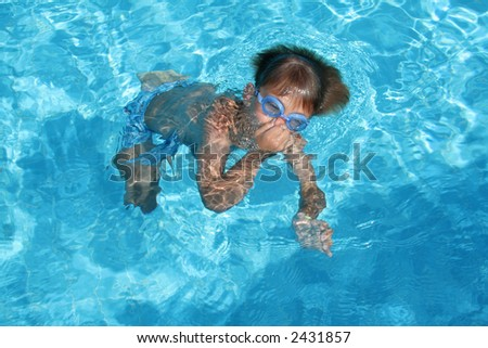 A child diving in a pool