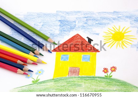 A child draw with an house  and flowers wity colorful pencils - stock photo