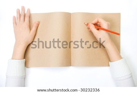 a child draws on the diary - stock photo