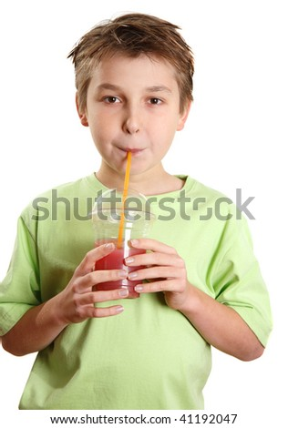 A child drinking a fresh berry juice packed full of vitamins and healthy nutrition. - stock photo