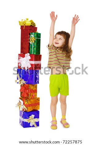 A child enjoys a lot of gifts for his birthday isolated on white background - stock photo