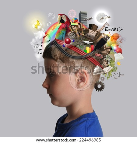 A child has various education and school objects on his head with a isolated background. Subjects are art, science, technology and nature. - stock photo