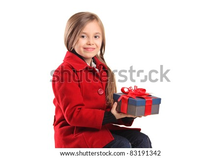 A child holding a gift isolated on white background