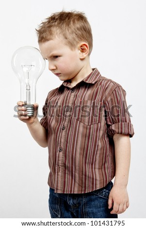 A child holding a large bulb. - stock photo