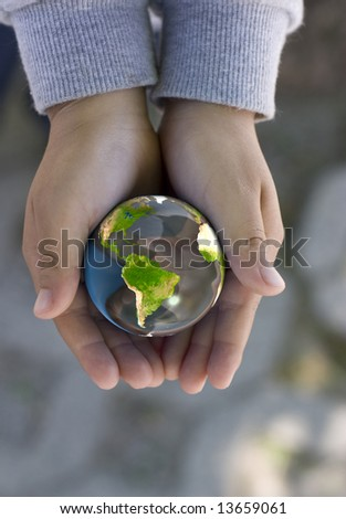 a child holds a globe, computer generated image, mapping image from NASA - stock photo